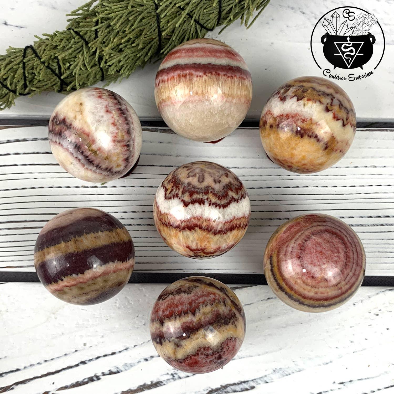 Banded Calcite (Pork Stone) Crystal Sphere Stones | Trada Marketplace